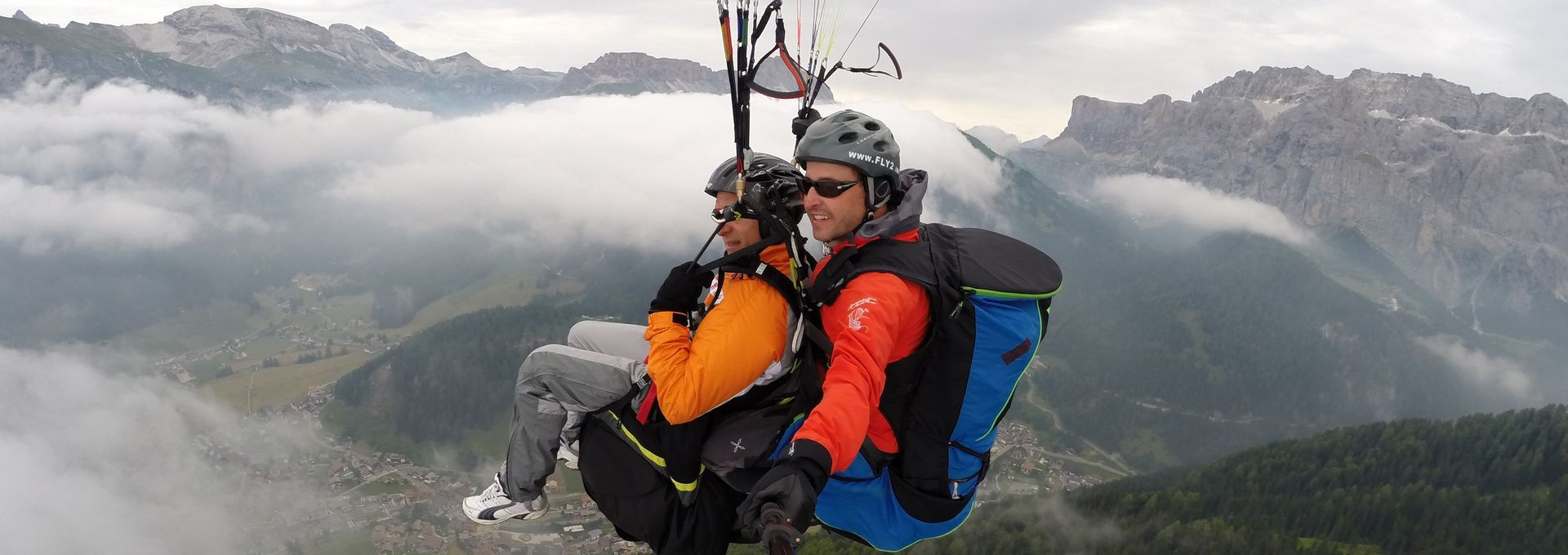 over the clouds - paragliding